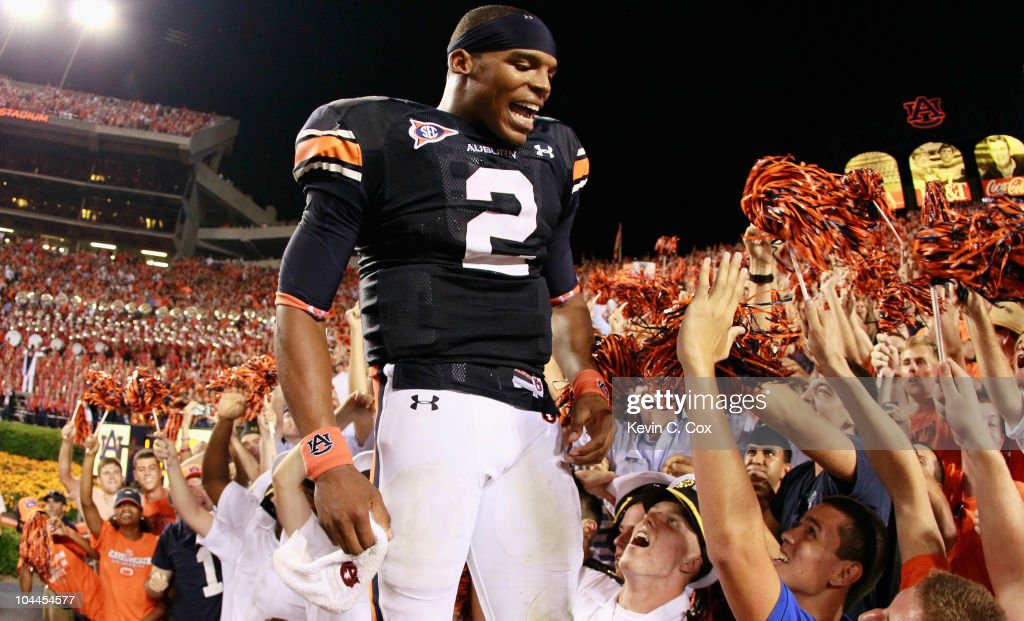 Quarterback Cameron Newton #2 of the Auburn Tigers celebrates in the stands after their 35-27 win over the South Carolina Gamecocks at Jordan-Hare Stadium on September 25, 2010 in Auburn, Alabama.
