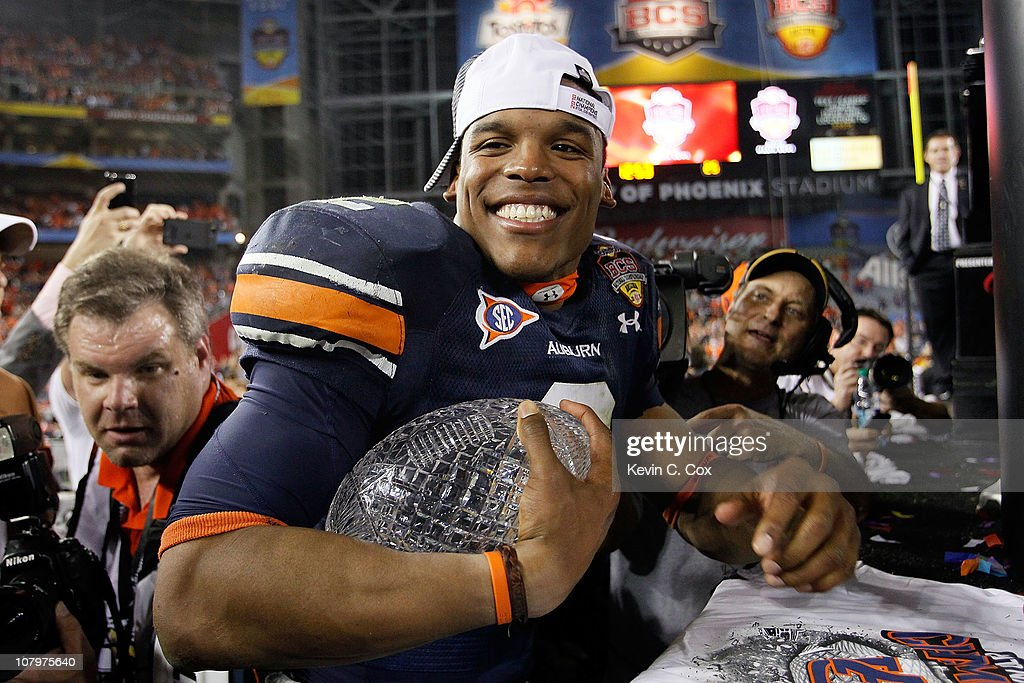 Quarterback Cameron Newton #2 of the Auburn Tigers celebrates the Tigers 22-19 victory against the Oregon Ducks in the Tostitos BCS National Championship Game at University of Phoenix Stadium on January 10, 2011 in Glendale, Arizona.