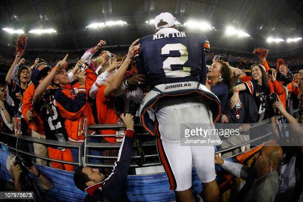 Quarterback Cameron Newton of the Auburn Tigers celebrates the Tigers 2219 victory with the fans after defeating the Oregon Ducks in the Tostitos BCS...