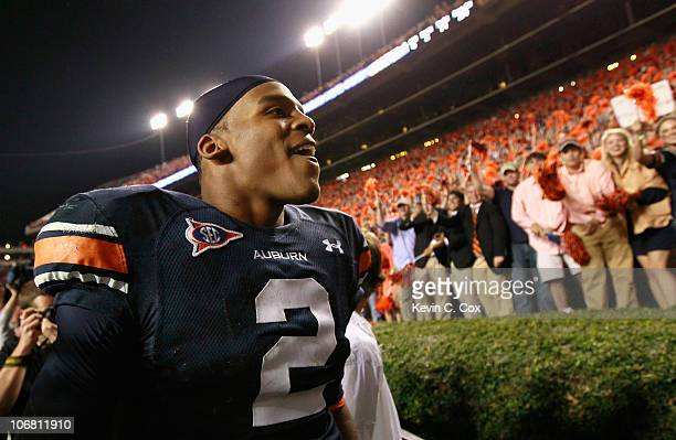 Quarterback Cameron Newton of the Auburn Tigers celebrates with fans after their 4931 win over the Georgia Bulldogs at JordanHare Stadium on November...