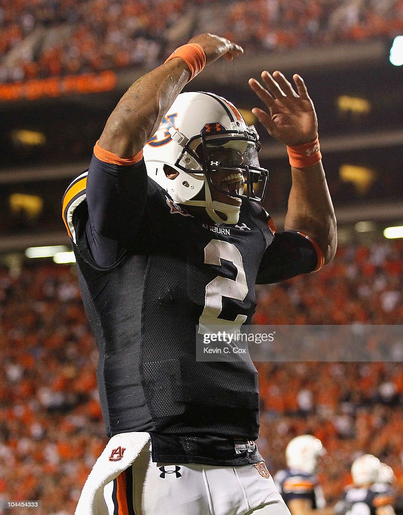 Quarterback Cameron Newton #2 of the Auburn Tigers reacts after passing for a touchdown against the South Carolina Gamecocks at Jordan-Hare Stadium on September 25, 2010 in Auburn, Alabama.