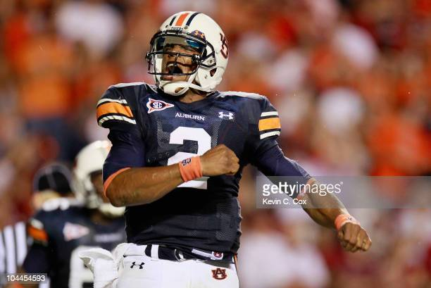 Quarterback Cameron Newton of the Auburn Tigers reacts after rushing in a touchdown against the South Carolina Gamecocks at JordanHare Stadium on...