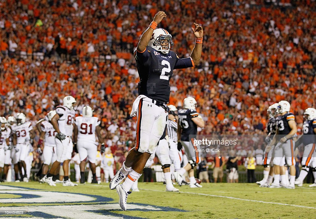 Quarterback Cameron Newton #2 of the Auburn Tigers reacts after rushing in a touchdown against the South Carolina Gamecocks at Jordan-Hare Stadium on September 25, 2010 in Auburn, Alabama.