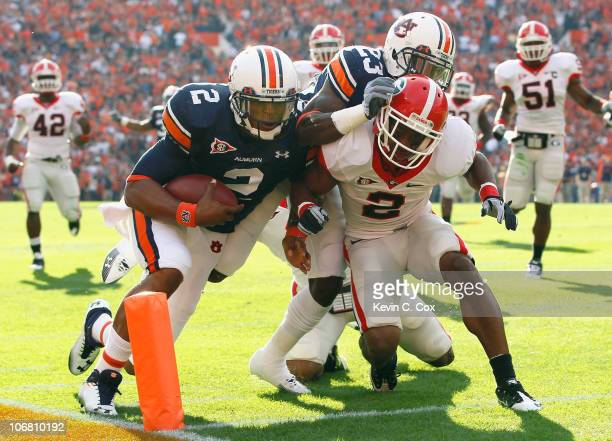 Quarterback Cameron Newton of the Auburn Tigers stays in bounds as he scores a touchdown against Brandon Boykin of the Georgia Bulldogs at JordanHare...