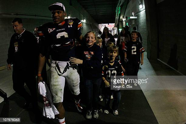 Quarterback Cameron Newton of the Auburn Tigers walks through the tunnel towards the locker room after the Tigers 2219 victory against the Oregon...