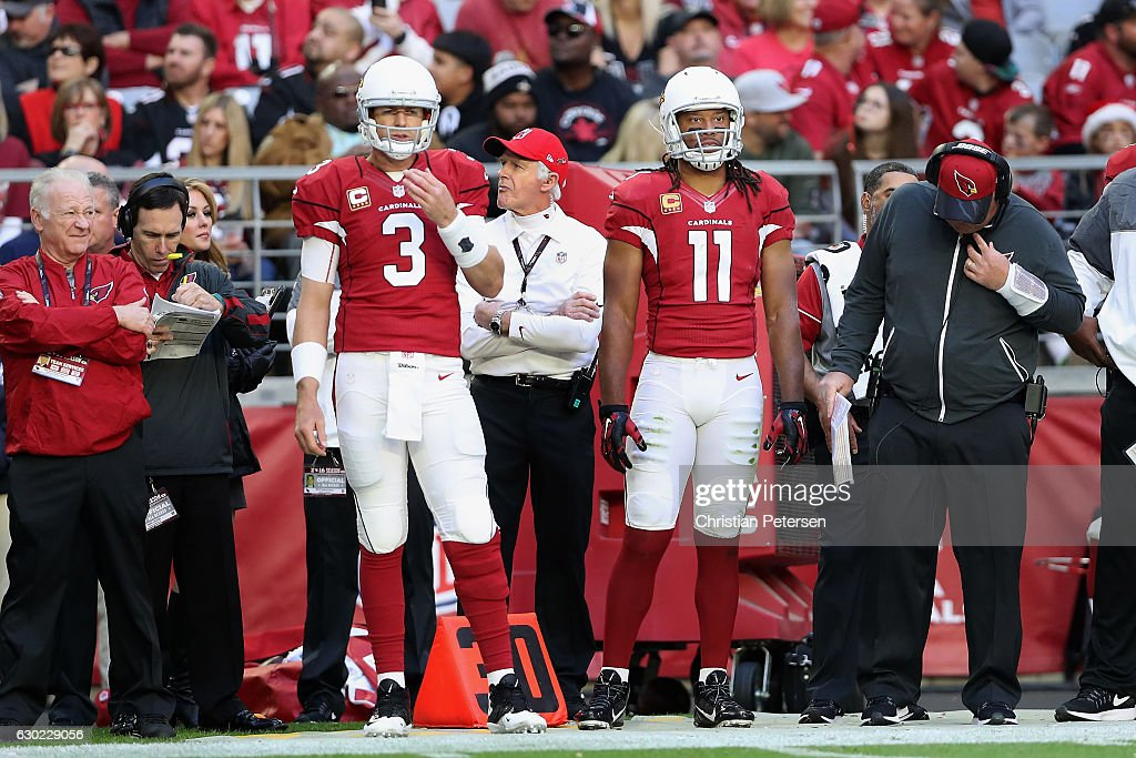 Quarterback Carson Palmer #3 and wide receiver Larry Fitzgerald #11 of the Arizona Cardinals stand on the sidelines during the NFL game against the New Orleans Saints at the University of Phoenix Stadium on December18, 2016 in Glendale, Arizona. The Saints defeated the Cardinals 48-41.