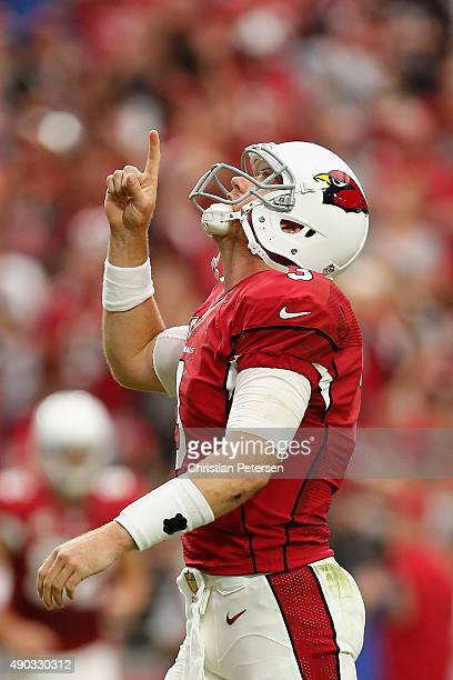 Quarterback Carson Palmer of the Arizona Cardinals celebrates after his team scores a touchdown in the second quarter of the NFL game against the San...
