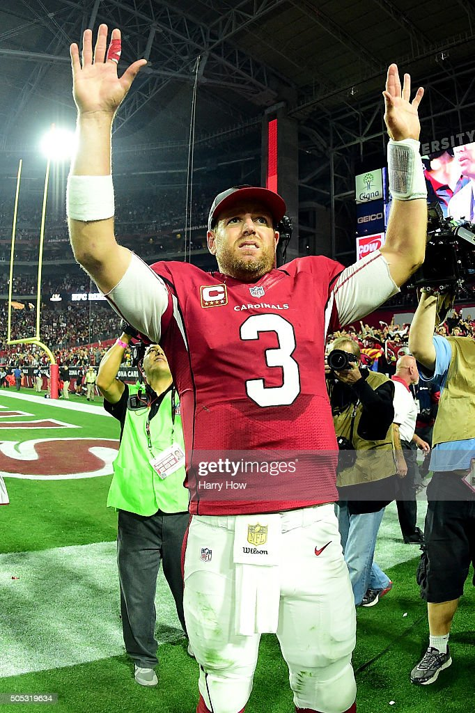 Quarterback Carson Palmer of the Arizona Cardinals celebrates after beating the Green Bay Packers 2620 in overtime of the NFC Divisional Playoff Game...