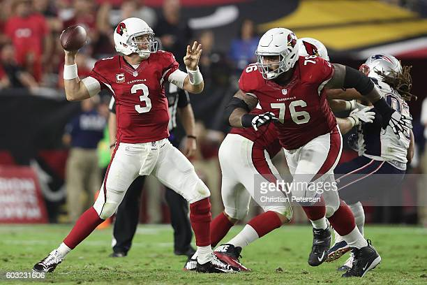 Quarterback Carson Palmer of the Arizona Cardinals drops back to pass during the NFL game against the New England Patriots at the University of...