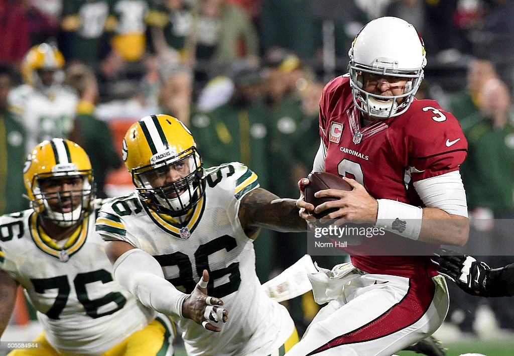 Quarterback <a gi-track='captionPersonalityLinkClicked' href=/galleries/search?phrase=Carson+Palmer&family=editorial&specificpeople=202556 ng-click='$event.stopPropagation()'>Carson Palmer</a> #3 of the Arizona Cardinals escapes the rush of outside linebacker <a gi-track='captionPersonalityLinkClicked' href=/galleries/search?phrase=Mike+Neal+-+American+Football+Player&family=editorial&specificpeople=11464524 ng-click='$event.stopPropagation()'>Mike Neal</a> #96 of the Green Bay Packers and throws the ball left to wide receiver Larry Fitzgerald #11 for a 75-yard gain in overtime in the NFC Divisional Playoff Game at University of Phoenix Stadium on January 16, 2016 in Glendale, Arizona.
