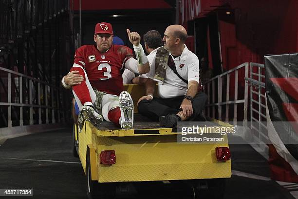 Quarterback Carson Palmer of the Arizona Cardinals is taken off the field on a cart after being injured in the fourth quarter of the NFL game against...