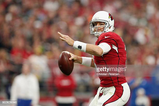 Quarterback Carson Palmer of the Arizona Cardinals looks to make a pass in the first half of the NFL game against the Green Bay Packers at the...