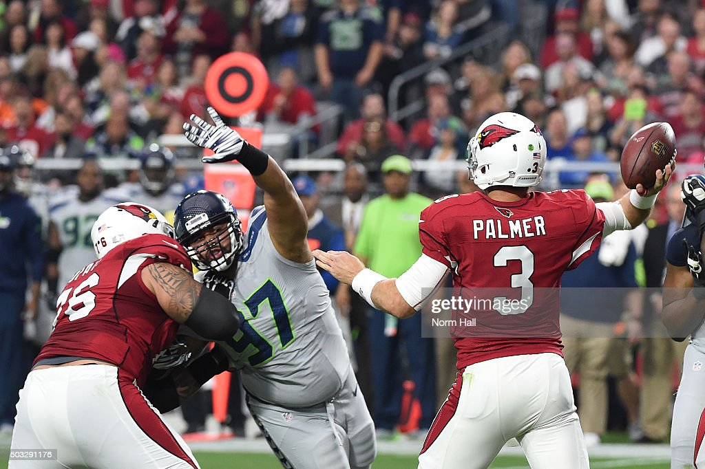 Quarterback <a gi-track='captionPersonalityLinkClicked' href=/galleries/search?phrase=Carson+Palmer&family=editorial&specificpeople=202556 ng-click='$event.stopPropagation()'>Carson Palmer</a> #3 of the Arizona Cardinals makes a pass in front of defensive tackle <a gi-track='captionPersonalityLinkClicked' href=/galleries/search?phrase=Jordan+Hill+-+American+Football+Player&family=editorial&specificpeople=13503545 ng-click='$event.stopPropagation()'>Jordan Hill</a> #97 of the Seattle Seahawks in the first half of the NFL game at University of Phoenix Stadium on January 3, 2016 in Glendale, Arizona.