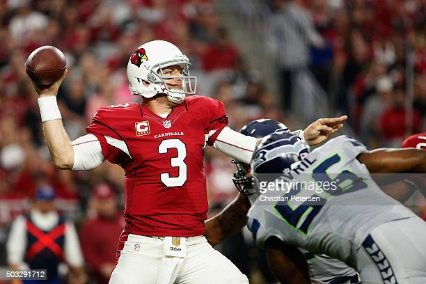 Quarterback Carson Palmer of the Arizona Cardinals makes a pass in the first half of the NFL game against the Seattle Seahawks at the University of...