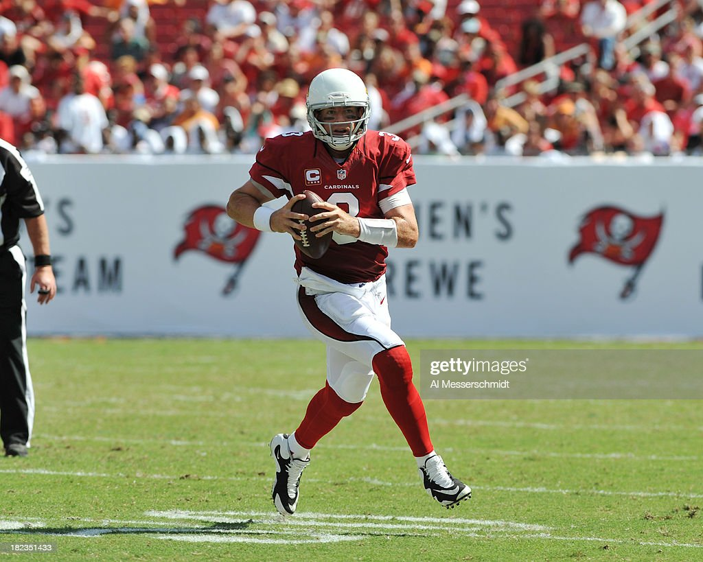 Quarterback <a gi-track='captionPersonalityLinkClicked' href=/galleries/search?phrase=Carson+Palmer&family=editorial&specificpeople=202556 ng-click='$event.stopPropagation()'>Carson Palmer</a> #3 of the Arizona Cardinals sets to pass in the 3rd quarter against the Tampa Bay Buccaneers September 29, 2013 at Raymond James Stadium in Tampa, Florida. Arizona won 13 - 10.