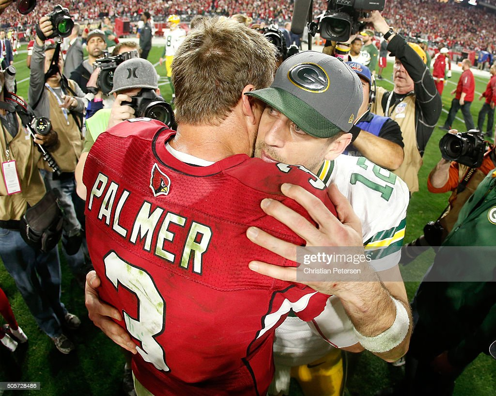 Quarterback Carson Palmer #3 of the Arizona Cardinals shakes hands with quarterback Aaron Rodgers #12 of the Green Bay Packers after the Arizona Cardinals beat the Green Bay Packers 26-20 in overtime of the NFC Divisional Playoff Game at University of Phoenix Stadium on January 16, 2016 in Glendale, Arizona.