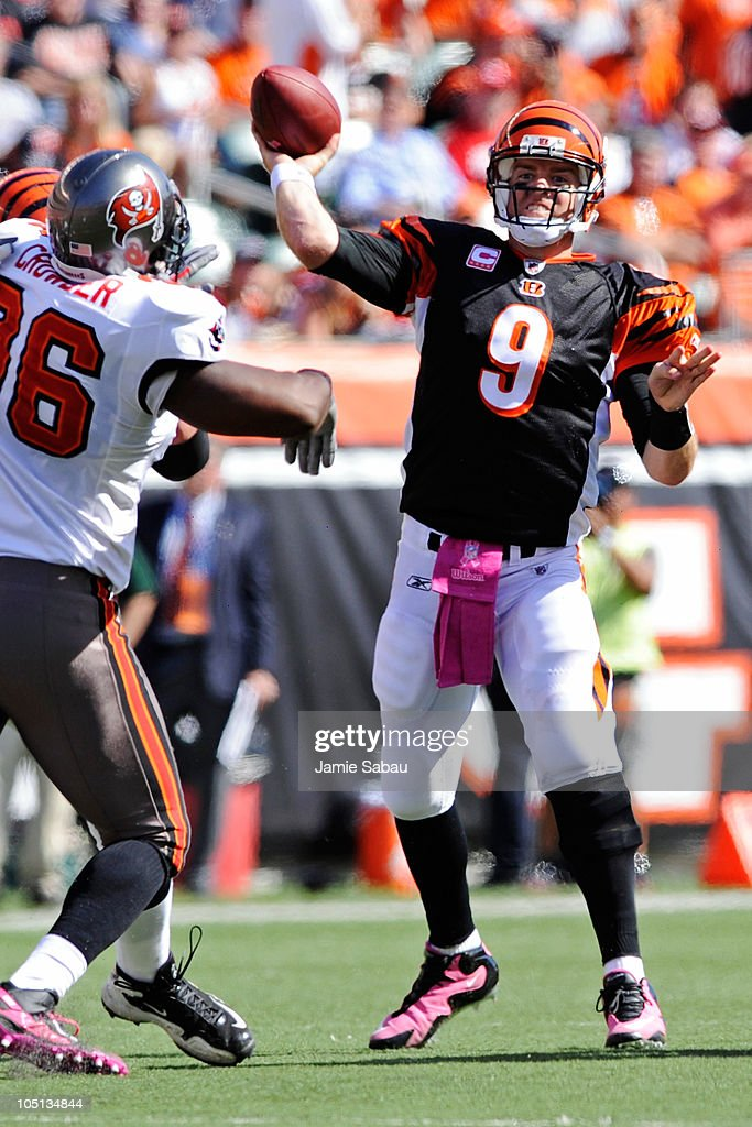 Quarterback <a gi-track='captionPersonalityLinkClicked' href=/galleries/search?phrase=Carson+Palmer&family=editorial&specificpeople=202556 ng-click='$event.stopPropagation()'>Carson Palmer</a> #9 of the Cincinnati Bengals gets off a pass against the Tampa Bay Buccaneers at Paul Brown Stadium on October 10, 2010 in Cincinnati, Ohio.