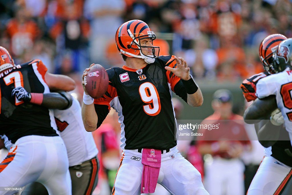 Quarterback <a gi-track='captionPersonalityLinkClicked' href=/galleries/search?phrase=Carson+Palmer&family=editorial&specificpeople=202556 ng-click='$event.stopPropagation()'>Carson Palmer</a> #9 of the Cincinnati Bengals gets set to throw from the pocket against the Tampa Bay Buccaneers at Paul Brown Stadium on October 10, 2010 in Cincinnati, Ohio.