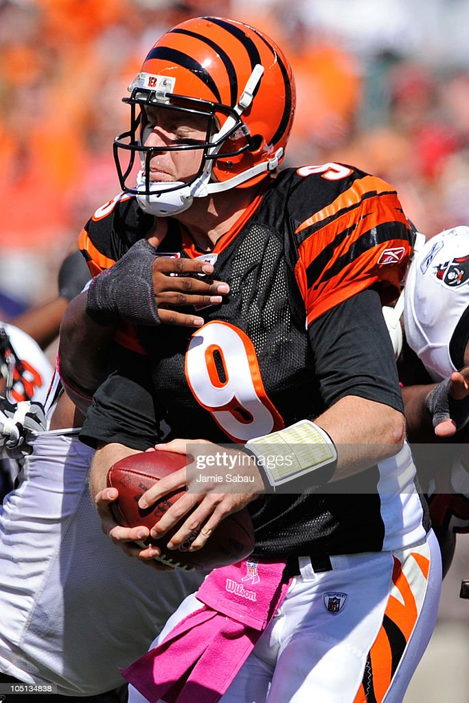 Quarterback <a gi-track='captionPersonalityLinkClicked' href=/galleries/search?phrase=Carson+Palmer&family=editorial&specificpeople=202556 ng-click='$event.stopPropagation()'>Carson Palmer</a> #9 of the Cincinnati Bengals is pressured by the Tampa Bay Buccaneers defense at Paul Brown Stadium on October 10, 2010 in Cincinnati, Ohio.