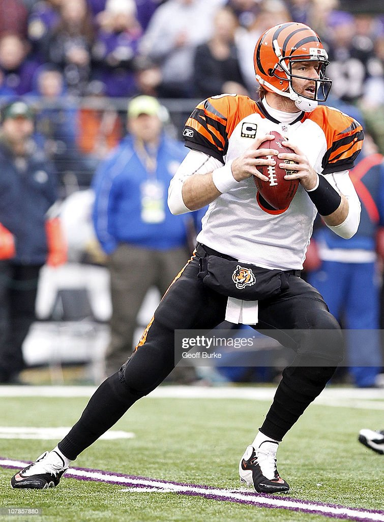 Quarterback Carson Palmer #9 of the Cincinnati Bengals prepares to throw the ball against the Baltimore Ravens at M&T Bank Stadium on January 2, 2011 in Baltimore, Maryland.