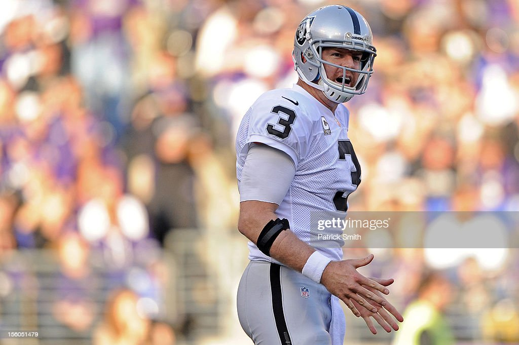 Quarterback <a gi-track='captionPersonalityLinkClicked' href=/galleries/search?phrase=Carson+Palmer&family=editorial&specificpeople=202556 ng-click='$event.stopPropagation()'>Carson Palmer</a> #3 of the Oakland Raiders reacts after an incomplete pass against the Baltimore Ravens in the second quarter at M&T Bank Stadium on November 11, 2012 in Baltimore, Maryland. The Baltimore Ravens won, 55-20.