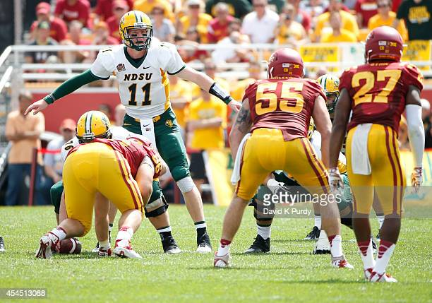 Quarterback Carson Wentz of the North Dakota State Bison calls a play at the line of scrimmage in the second half of play against the Iowa State...