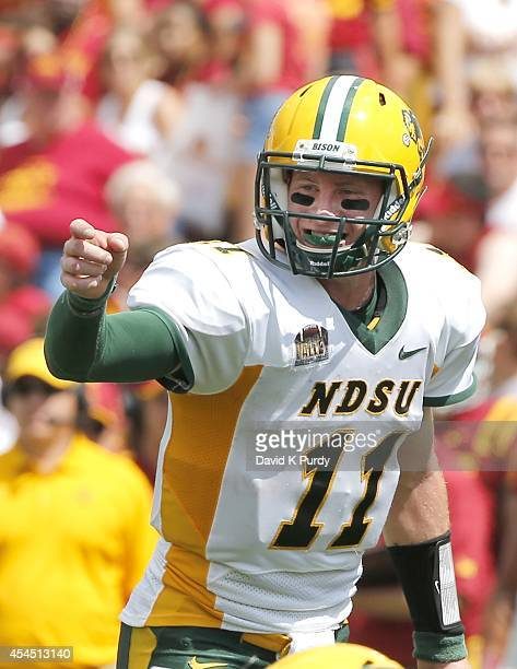 Quarterback Carson Wentz of the North Dakota State Bison calls a play in the second half of play against the Iowa State Cyclones at Jack Trice...