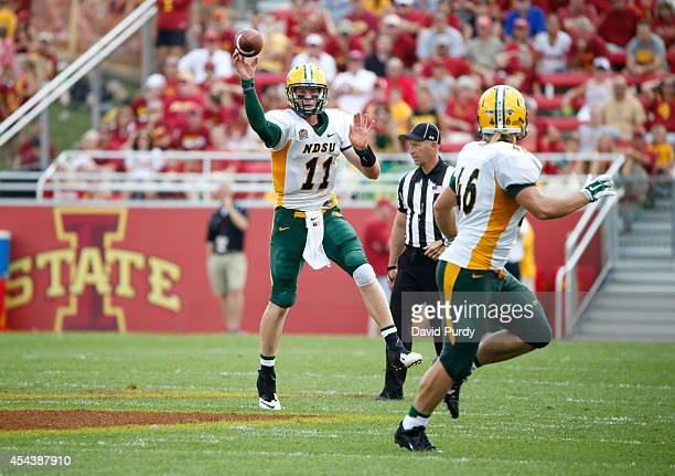 Quarterback Carson Wentz of the North Dakota State Bison passes to teammate fullback Andrew Bonnet of the North Dakota State Bison in the second half...