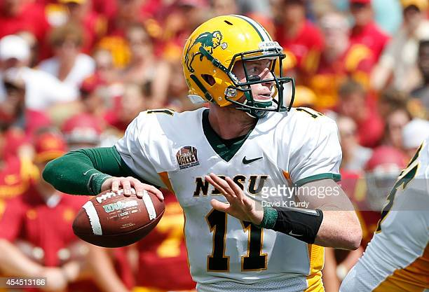 Quarterback Carson Wentz of the North Dakota State Bison throws the ball in the second half of play against the Iowa State Cyclones at Jack Trice...