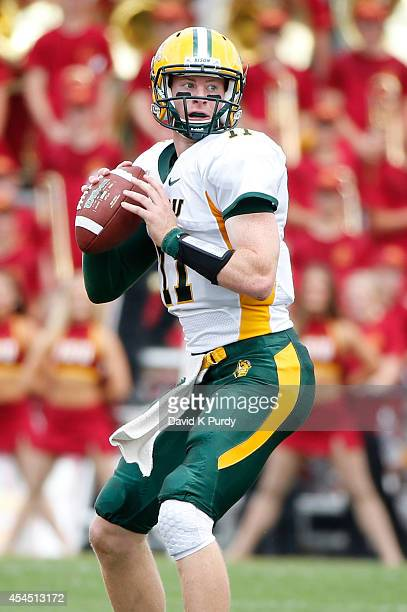 Quarterback Carson Wentz of the North Dakota State Bison throws the ball in the first half of play against the Iowa State Cyclones at Jack Trice...