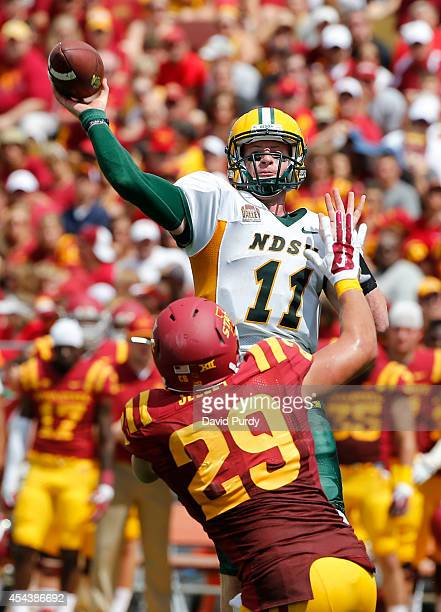 Quarterback Carson Wentz of the North Dakota State Bison throws under pressure from linebacker Kane Seeley of the Iowa State Cyclones in the second...