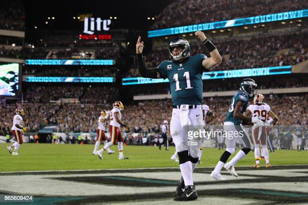 Quarterback Carson Wentz of the Philadelphia Eagles celebrates a touchdown by teammate Nelson Agholor during the fourth quarter of the game against...