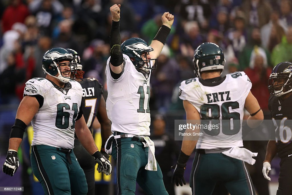 Quarterback Carson Wentz #11 of the Philadelphia Eagles celebrates after scoring a fourth quarter touchdown against the Baltimore Ravens at M&T Bank Stadium on December 18, 2016 in Baltimore, Maryland.