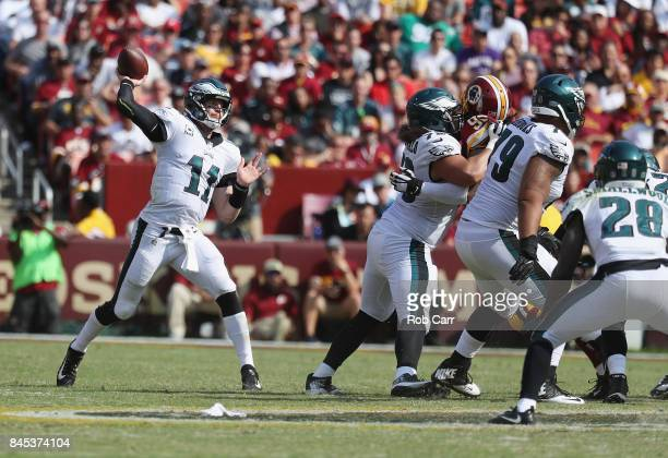 Quarterback Carson Wentz of the Philadelphia Eagles completes a pass agianst the Washington Redskins in the fourth quarter at FedExField on September...