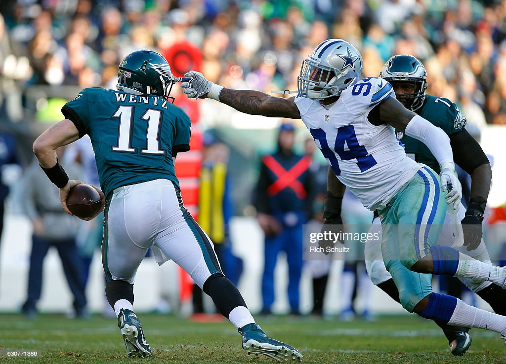 Quarterback Carson Wentz #11 of the Philadelphia Eagles escapes Randy Gregory #94 of the Dallas Cowboys during the third quarter of a game at Lincoln Financial Field on January 1, 2017 in Philadelphia, Pennsylvania. The Eagles defatted the Cowboys 27-13.