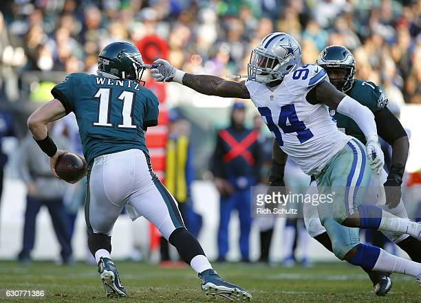Quarterback Carson Wentz of the Philadelphia Eagles escapes Randy Gregory of the Dallas Cowboys during the third quarter of a game at Lincoln...