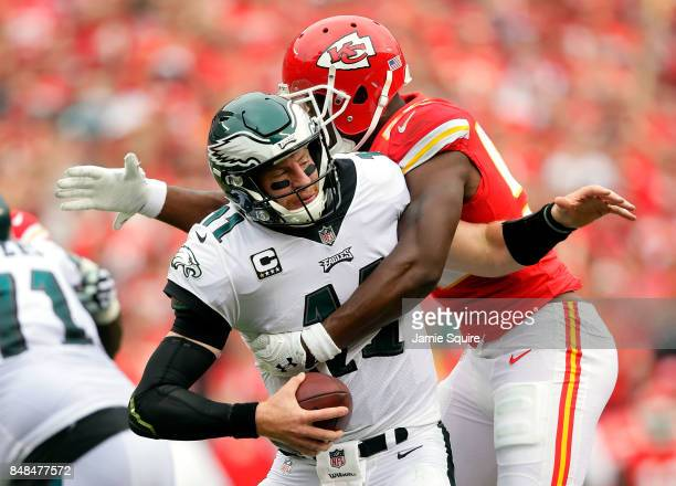 Quarterback Carson Wentz of the Philadelphia Eagles is sacked by outside linebacker Dee Ford of the Kansas City Chiefs during the 1st half of the...