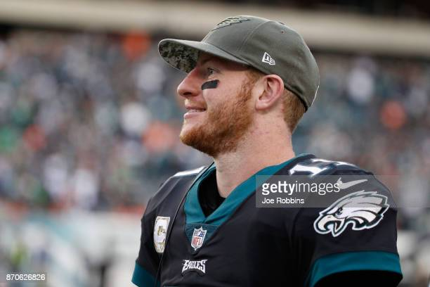 Quarterback Carson Wentz of the Philadelphia Eagles looks on against the Denver Broncos during the fourth quarter at Lincoln Financial Field on...