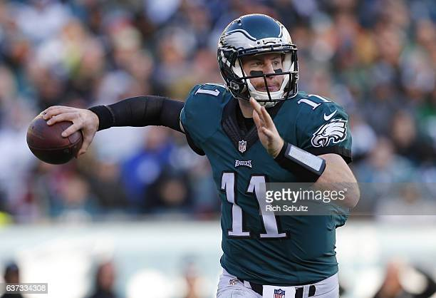 Quarterback Carson Wentz of the Philadelphia Eagles looks to pass against the Dallas Cowboys during the third quarter of a game at Lincoln Financial...
