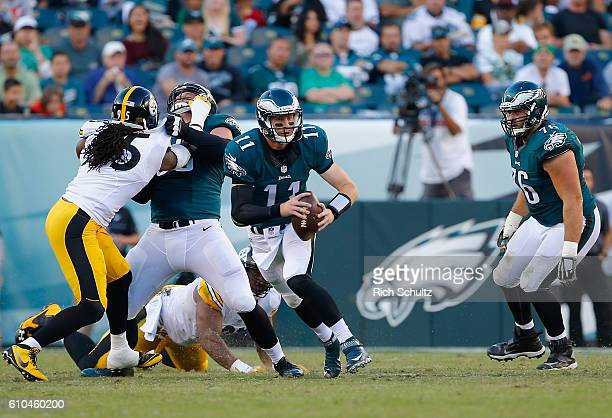 Quarterback Carson Wentz of the Philadelphia Eagles looks to pass the ball against the Pittsburgh Steelers in the third quarter at Lincoln Financial...