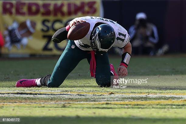 Quarterback Carson Wentz of the Philadelphia Eagles reacts after a play against the Washington Redskins in the fourth quarter at FedExField on...