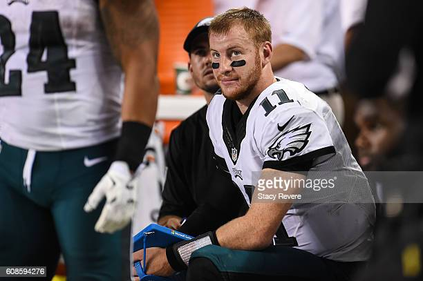 Quarterback Carson Wentz of the Philadelphia Eagles sits on the bench in the second half against the Chicago Bears at Soldier Field on September 19...