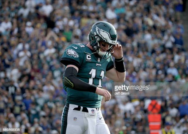 Quarterback Carson Wentz of the Philadelphia Eagles walks off the field against the Los Angeles Rams during the second quarter at Los Angeles...