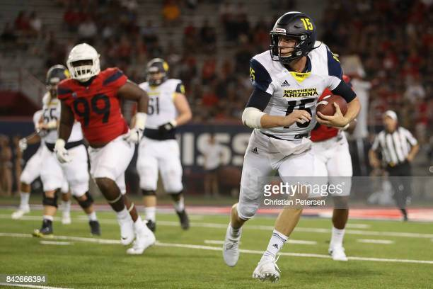 Quarterback Case Cookus of the Northern Arizona Lumberjacks scrambles with the football during the second half of the college football game against...