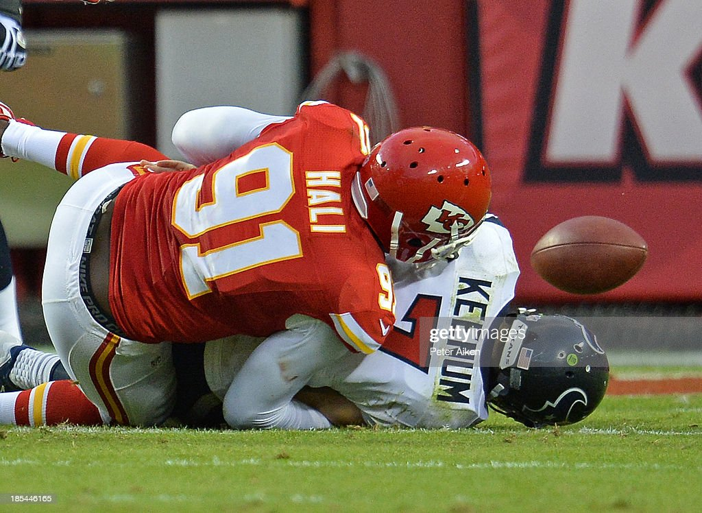Quarterback Case Keenum #7 of the Houston Texans fumbles as he is sacked by linebacker Tamba Hali #91 of the Kansas City Chiefs during the fourth quarter on October 20, 2013 at Arrowhead Stadium in Kansas City, Missouri.
