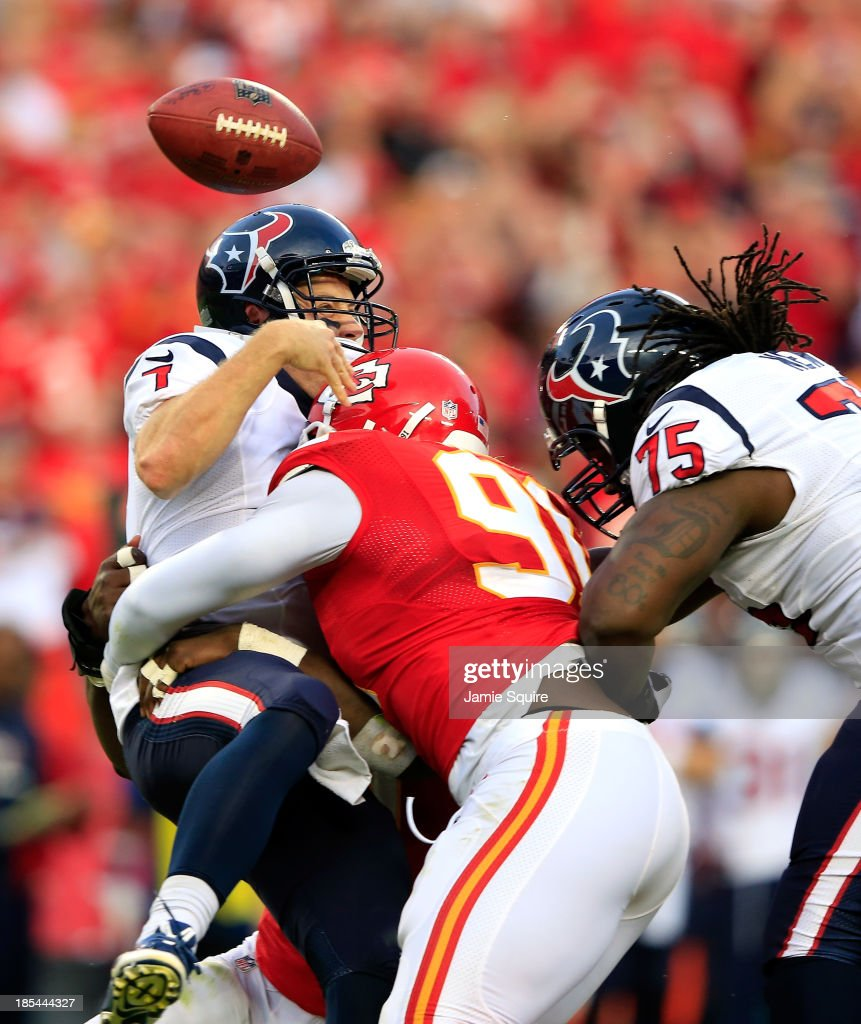 Quarterback Case Keenum #7 of the Houston Texans loses the ball as he is sacked by outside linebacker Tamba Hali #91 of the Kansas City Chiefs as tackle Derek Newton #75 tries to block late in the 2nd half of the game at Arrowhead Stadium on October 20, 2013 in Kansas City, Missouri.