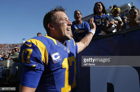 Quarterback Case Keenum of the Los Angeles Rams high fives fans as he leaves the field after his team's 93 victory over the Seattle Seahawks in the...