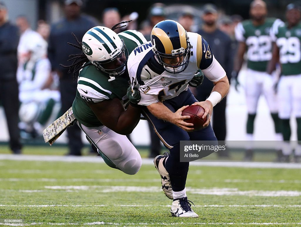 Quarterback Case Keenum #17 of the Los Angeles Rams is sacked by Steve McLendon #99 of the New York Jets in the third quarter at MetLife Stadium on November 13, 2016 in East Rutherford, New Jersey.