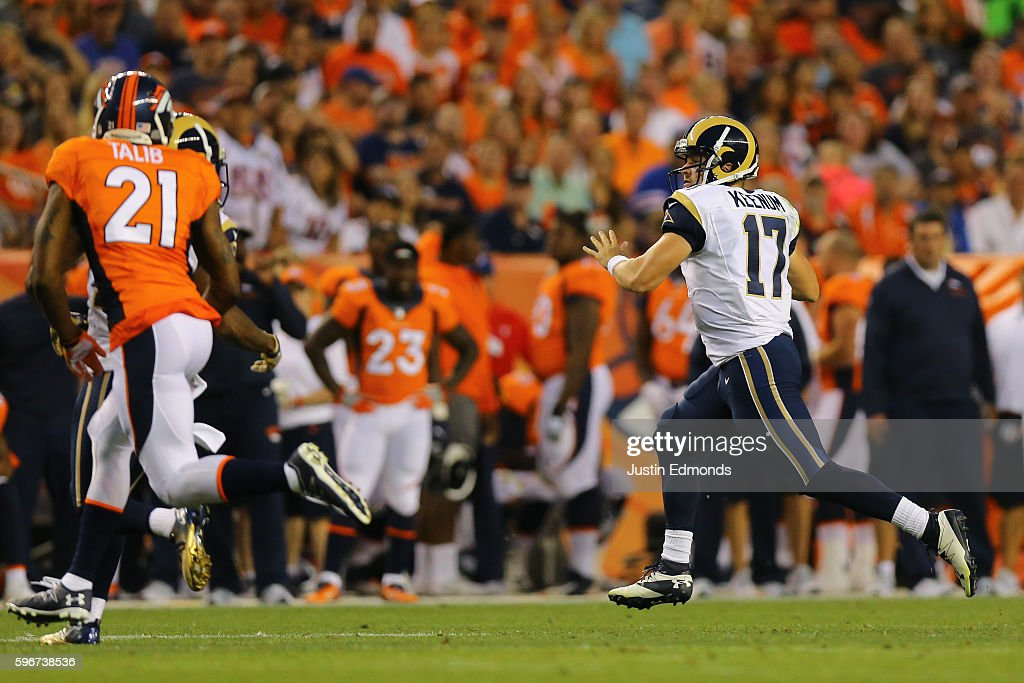 Quarterback Case Keenum #17 of the Los Angeles Rams runs with the football during the second quarter against the Denver Broncos at Sports Authority Field at Mile High on August 27, 2016 in Denver, Colorado.