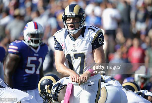 Quarterback Case Keenum of the Los Angeles Rams signals to his team during the fourth quarter of the game against the Buffalo Bills at the Los...